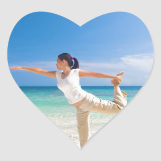beach yoga performed by a matured asian female heart sticker
