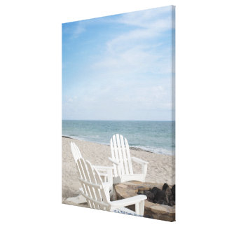 beachfront house with adirondack chairs and canvas print