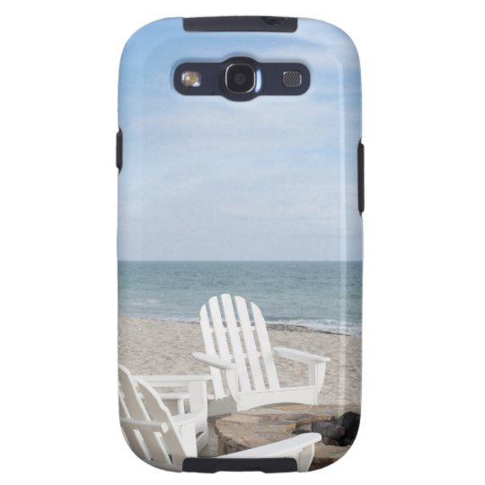 beachfront house with adirondack chairs and galaxy SIII case