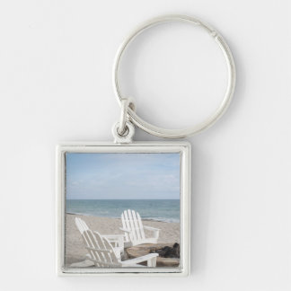 beachfront house with adirondack chairs and keychain