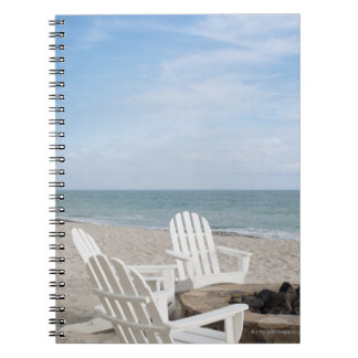 beachfront house with adirondack chairs and notebook