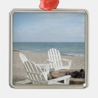beachfront house with adirondack chairs and square metal christmas ornament