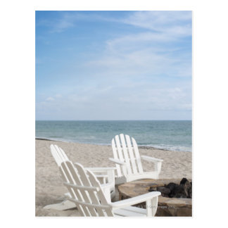beachfront house with adirondack chairs and postcard