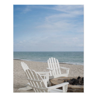 beachfront house with adirondack chairs and poster