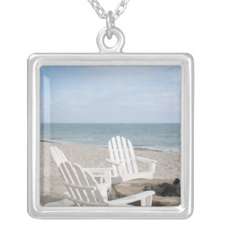 beachfront house with adirondack chairs and silver plated necklace