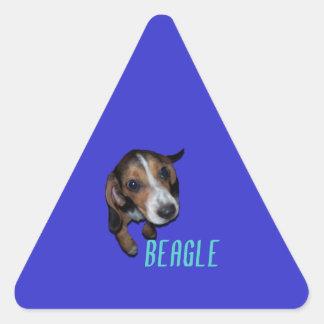Beagle Puppy Sitting - Blue Background Triangle Sticker