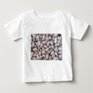 Bean rounded with red specks texture background baby T-Shirt