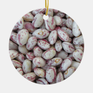 Bean rounded with red specks texture background ceramic ornament