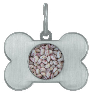 Bean rounded with red specks texture background pet tag