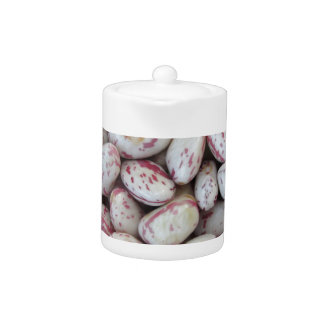 Bean rounded with red specks texture background teapot