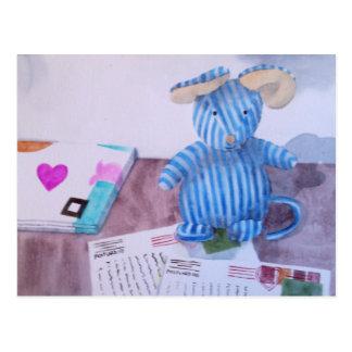 Beanie writes his postcards