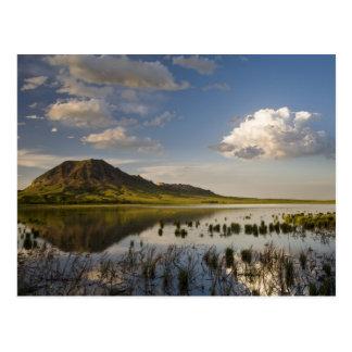 Bear Butte reflects into Bear Butte Lake near Postcard