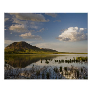 Bear Butte reflects into Bear Butte Lake near Poster