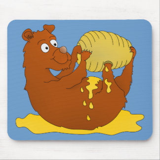 Bear eating from a beehive mouse pad