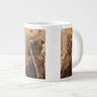 bear playing with a stick large coffee mug