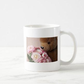bear smelling roses mug