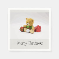 Bear with golf ball and gifts on Christmas napkin