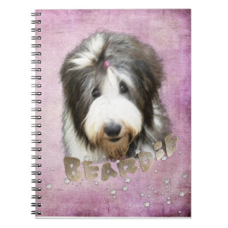 Bearded collie face, pink note books
