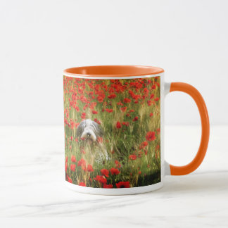 Bearded collie in poppies field. mug
