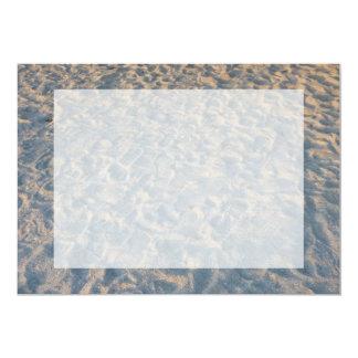 Beautful footprints all over beach sand, blue pink card