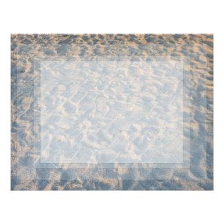 Beautful footprints all over beach sand, blue pink letterhead
