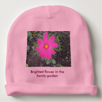 Beautiful baby girl shines in garden of family baby beanie