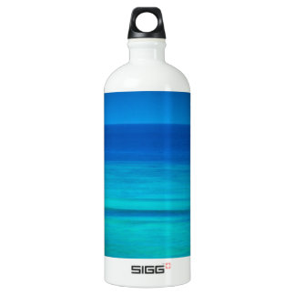 Beautiful Blue Ocean with white sailboat Water Bottle