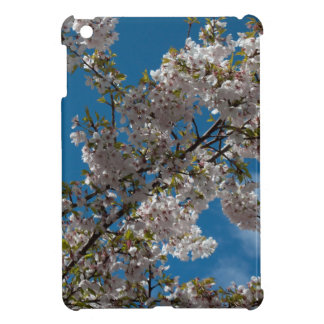 Beautiful cherry blossoming tree against blue sky. case for the iPad mini