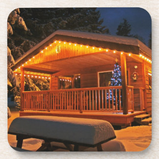 Beautiful Christmas Lights on Log Cabin in Snow Drink Coaster