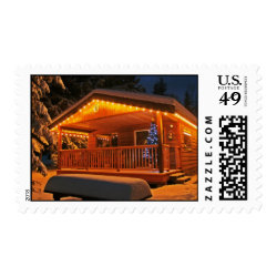 Beautiful Christmas Lights on Log Cabin in Snow Postage