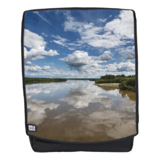 Beautiful clouds over river, reflection in water backpack