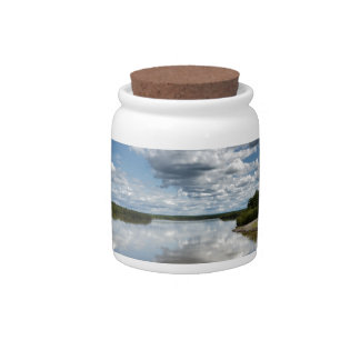Beautiful clouds over river, reflection in water candy jar