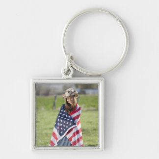 Beautiful cowgirl wrapped in American flag Keychain