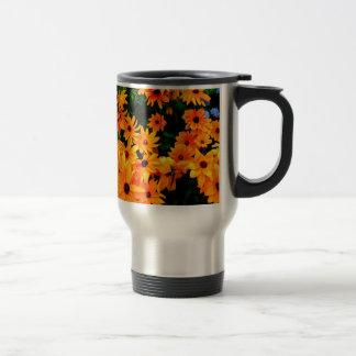 Beautiful display or orange and yellow flowers travel mug