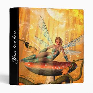 Beautiful fairy sitting on a mushroom binder