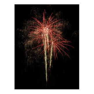 Beautiful fireworks on the black sky background postcard