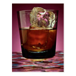 Beautiful glass filled with Whiskey and ice cube Post Card