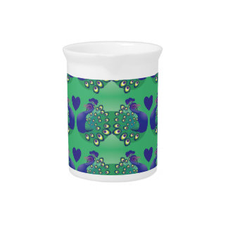 Beautiful green and blue peacocks birds with tail drink pitchers