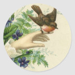 Beautiful hand with a bird and flowers runde aufkleber