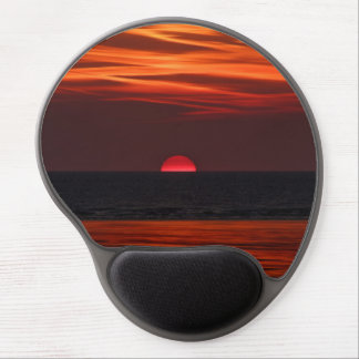 Beautiful image of the sun setting over the water gel mouse pad