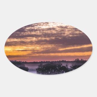 beautiful morning sunrise over farm land florida t oval sticker