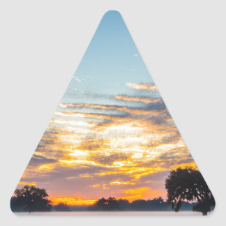 beautiful morning sunrise over farm land florida t triangle sticker