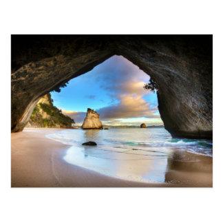 Beautiful Ocean Rock Arch Formation on Beach Postcard