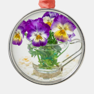 beautiful pansy flowers isolated in a cup round metal christmas ornament