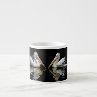Beautiful pelicans reflection on black background espresso cup