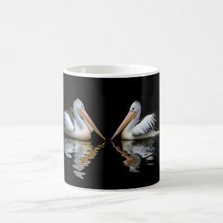 Beautiful pelicans reflection on black background magic mug