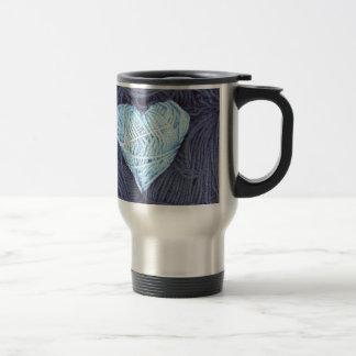Beautiful photograph of blue wool heart travel mug