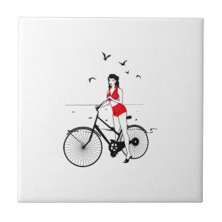 Beautiful pin-up girl on bicycle. Elegant stylish Tile