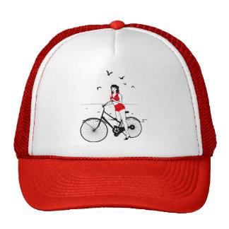 Beautiful pin-up girl on bicycle. Elegant stylish Trucker Hat