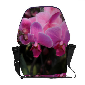 beautiful pink orchid flowers.  floral photography courier bag
